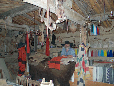 """Dan Deuter's """"trading post"""" in another rebuilt 1800's log cabin. Both structures, along with other cabins and props are used in artists' photoshoots he conducts each year on his property."""